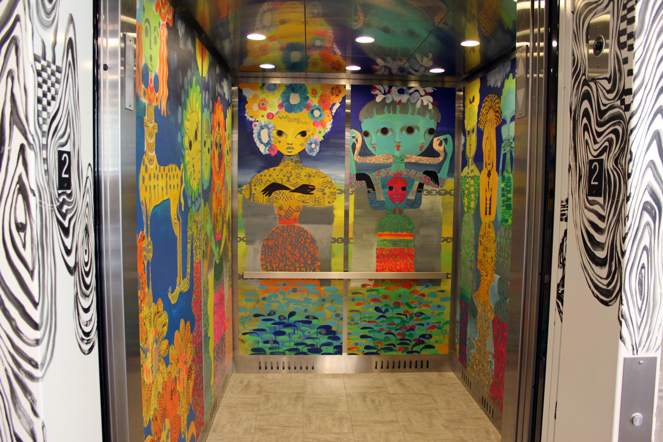 ... of the elevator and infused the interior with a carnival of color